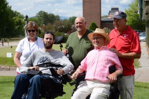 Ben Damon and his parents with Travis and Lee Roy at the Merlino's golf tournament in 2016.